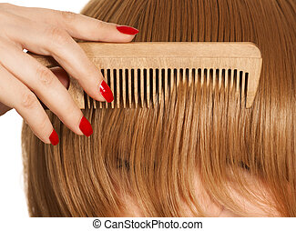 Comb hair close-up