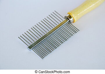 comb with teeth away and fine side for dog and cat on white background