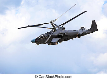 Combat helicopter in flight - Attack helicopter armed with ...