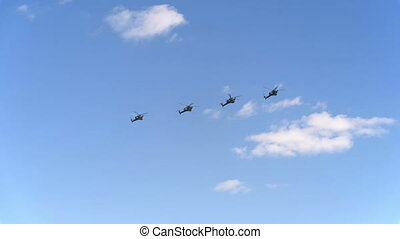 Combat helicopters Mi-28 fly in blue sky
