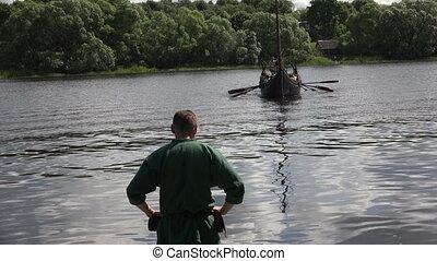 Combat Viking ship. Medieval warriors. Shot in 4K...