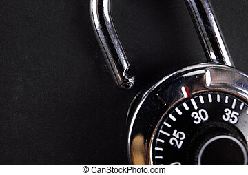 combination lock close up on black background. safe concept.