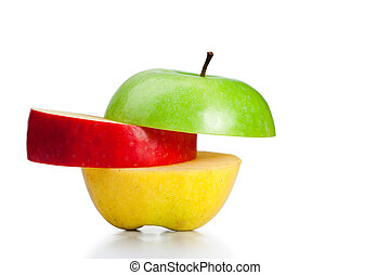 Combination of green, yellow and red apples on a white...