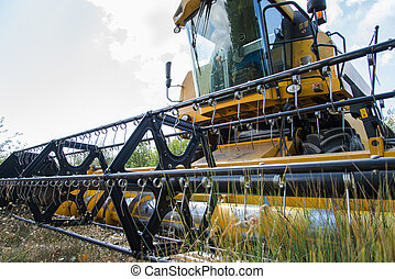 combine harvester - detail the front of a combine