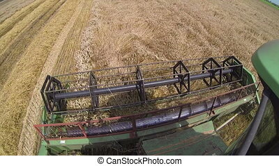 Combine Harvester in Action on the Weat Field