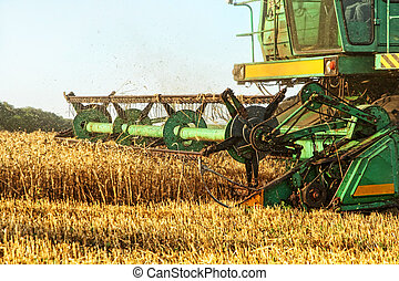 Combine harvester in agriculture field closeup.
