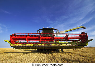 Combine harvester parked on the field
