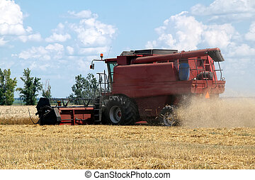 Combine harvester working on a wheat field