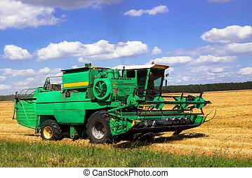Combine harvester working on the field