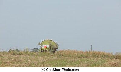 Combine green standing in a field