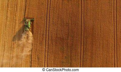 Combine with field, aerial view.