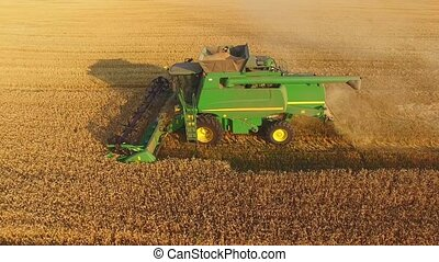 Combine working in the field.