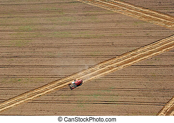 Combine working in the fields - Aerial View : combine ...