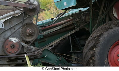 Combine working on sunflower field. Agricultural combine...
