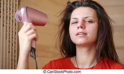Combing hair dryer - Young girl doing hair with hair dryer