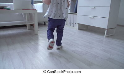 Combining Work with Childcare - Tracking shot of toddler...