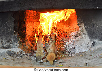 Combustion - Burning using firewood as fuel.