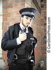 Police man talking down a radio