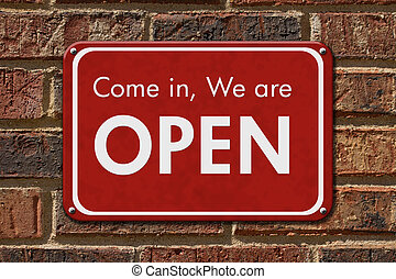 Come in We are Open Sign, A red hanging sign with text Come in We are Open on a brick wall