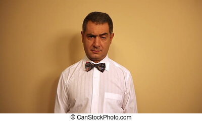 Comedian acting as pilot - Comedian wearing bow tie acting...