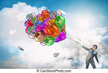 Comedian man with color balloons . Mixed media - Young funny...