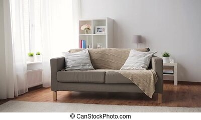 sofa with cushions at cozy home living room - comfort,...