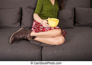 comfort with cup on sofa