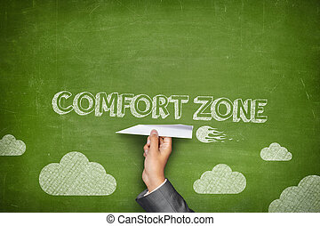 Comfort zone concept on green blackboard with businessman...