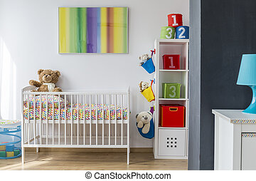 View of comfortable and pretty cradle in bright child room