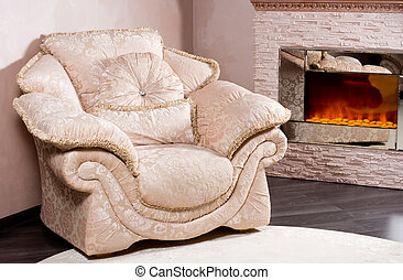 Comfortable armchair near a blazing fire