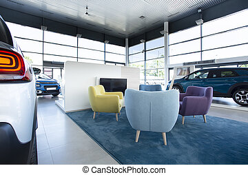 Comfortable armchairs for customers in the middle of a car showroom