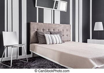 Comfortable bed in bedroom