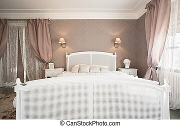 Comfortable bed in bedroom