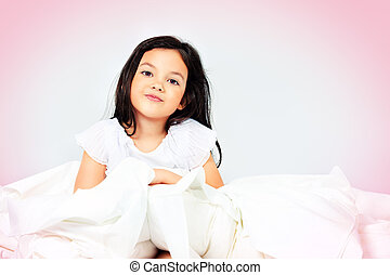 comfortable bed - Sweet little girl is going to sleep in a ...