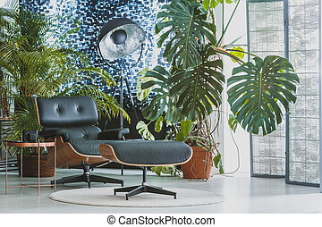 Comfortable black chair in apartment