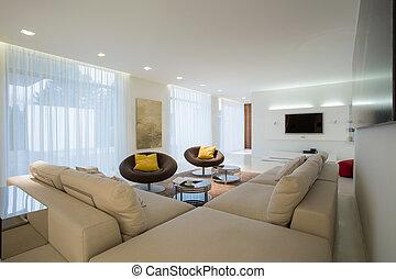 Comfortable corner sofa in contemporary drawing room