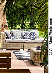 Comfortable couch on patio