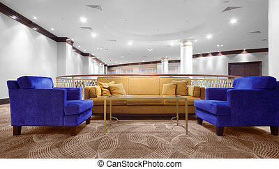 Comfortable divan and two armchair inside lighting hall with...