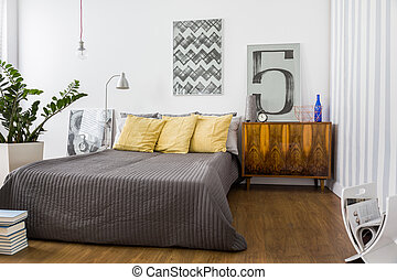 Comfortable double bed in modern stylish bedroom