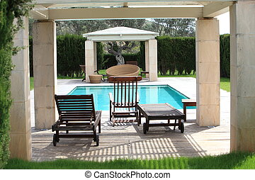 Comfortable furniture at the swimming pool