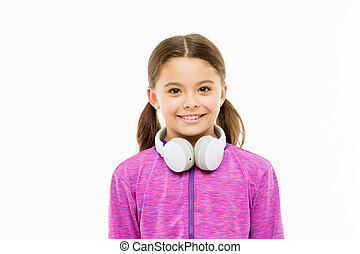 Comfortable headphones for easy listening comfort. Little girl wearing headphones isolated on white. Small child with wireless sports headphones. Cute kid enjoying over ear stereo headphones