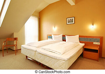 Comfortable hotel room with white bed