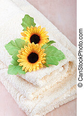 comfortable soft hotel towels with flowers on top