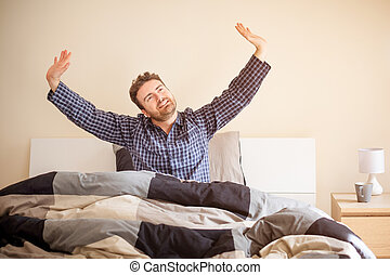 Comfortable man after good sleep in bed