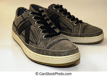 A pair of used comfortable shoes on a white background