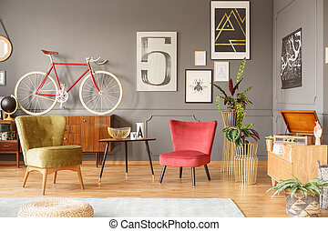 Comfortable vintage armchairs and bicycle