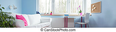 Comfortable white couch in stylish blue children room