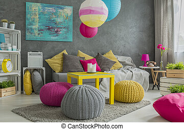 Trendy comfortable wool hassock in colorful room interior