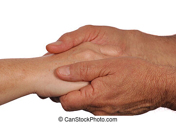 Man holds woman's hand tenderly