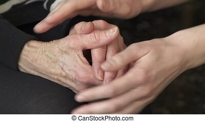 comforting hands - young hands comforting older hands